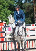 SAINT PETERSBURG-JULY 06: Rider Andis Varna on Coradina — Stock Photo