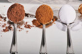 Spoons with baking ingredients — Stock Photo