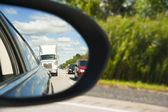 Side mirror view of the traffic behind — Stock Photo