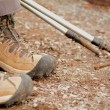 Hiking boots on the ground — Stock Photo