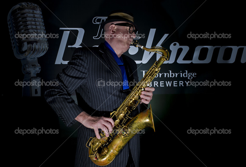 "Musician Bob Swift playing the tenor saxophone during a gig at the Greystones with his four-piece rhythm & blues band ""The Hummingbirds"" in Sheffield, March 23 2012. — Stock Photo #12938742"