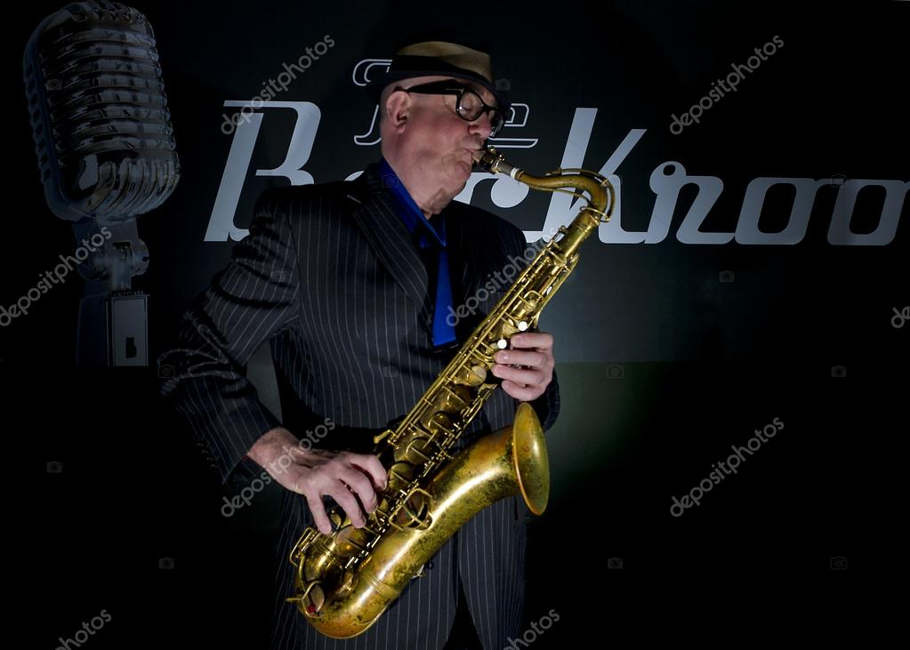 "Musician Bob Swift playing the tenor saxophone during a gig at the Greystones with his four-piece rhythm & blues band ""The Hummingbirds"" in Sheffield, March 23 2012. — Stock Photo #12940223"