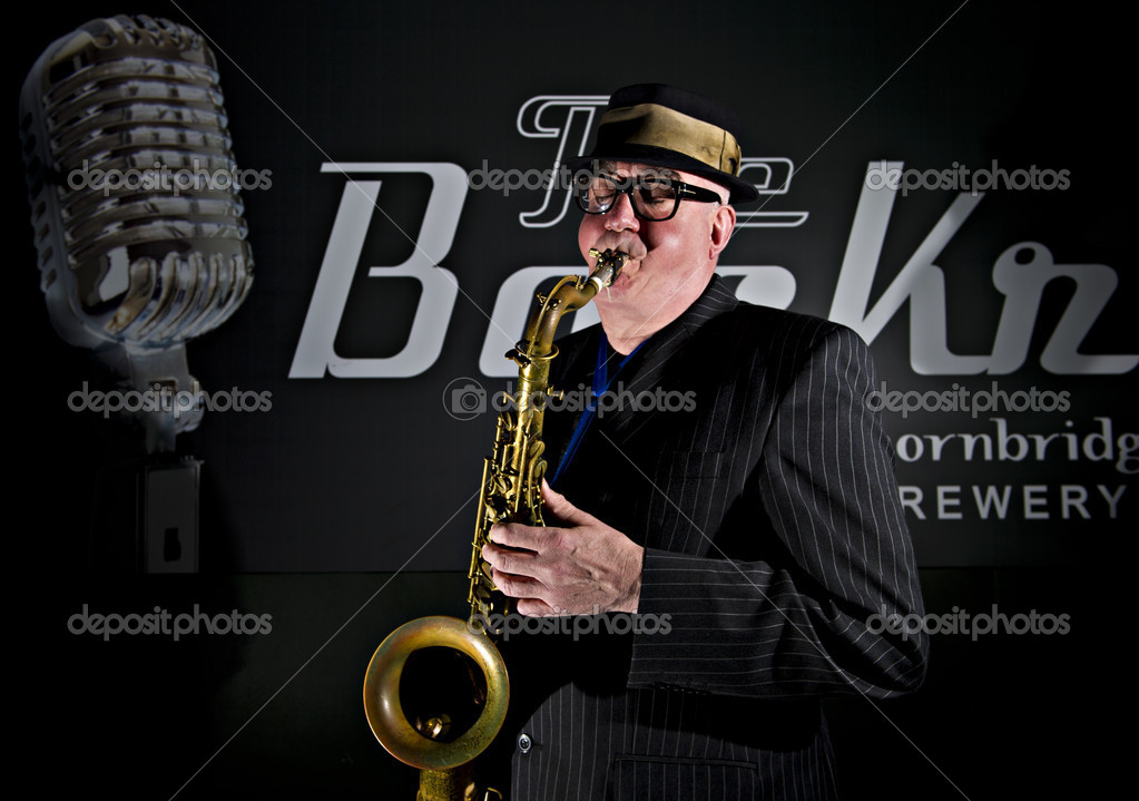 "Musician Bob Swift playing the tenor saxophone during a gig at the Greystones with his four-piece rhythm & blues band ""The Hummingbirds"" in Sheffield, March 23 2012. — Stock Photo #12940844"