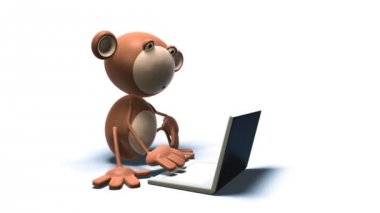 Monkey using a laptop (loopable) — Stock Video