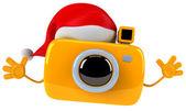 Fun camera in the Santa hat — Stock Photo