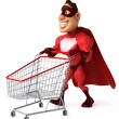 Superhero with shopping cart — Stock fotografie