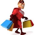 Superhero holding shopping bags — Stock Photo