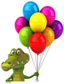 Crocodile with colorful balloons — Stock Photo