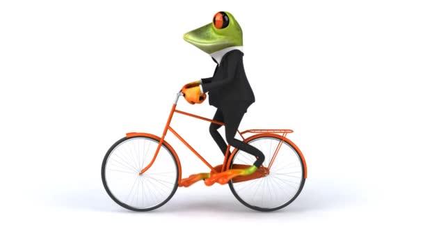 Rana en traje de paseos en bicicleta de la diversión — Vídeo de stock