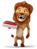 Lion with steak — Stock Photo