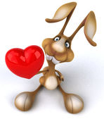 Fun rabbit holding red heart — Stock Photo