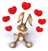 Fun rabbit with heart around — Stock Photo