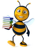 Fun bee with stack of books — Stockfoto