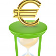 Euro sign on a green sand glass. — Stock Photo #13435582