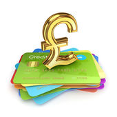 Pound sterling sign on a colorful credit cards. — Stock Photo