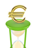 Euro sign on a green sand glass. — Stock Photo