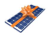 Солнечная батарея, украшенный оранжевой ленточкой. — Стоковое фото