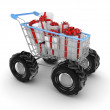 Stylized shopping trolley with a gift boxes. — Stock Photo #13582687
