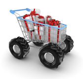 Stylized shopping trolley with a gift boxes. — Stock Photo