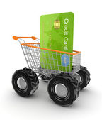 Green credit card in a shopping trolley. — Stock Photo