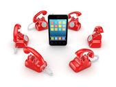 Red vintage telephones around modern mobile phone. — Stock Photo
