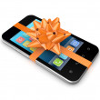 Modern mobile phone decorated with an orange ribbon. - Zdjęcie stockowe