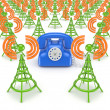 Green antennas and blue vintage telephone. — Stock Photo