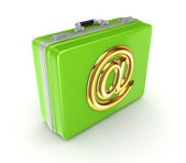 Green suitcase with golden AT symbol. — Стоковое фото