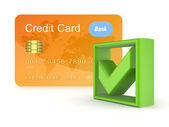 Green tick mark and orange credit card. — Stock Photo