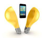Mobile phone inside yellow lamp. — Stock Photo