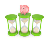 Pink piggy bank and green sand glasses. — Stock Photo