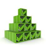 Yeşil onay işaretleri yapılan piramit. — Stok fotoğraf