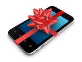 赤いリボンで飾られた現代の携帯電話. — ストック写真