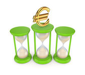 Sand glasses and euro symbol. — Stock Photo