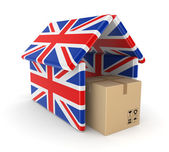 Carton box under the roof made of english flags. — Stock Photo