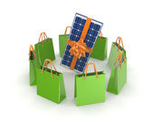 Green packets around solar battery. — Stock Photo