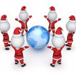 Stock Photo: Santas around Earth.