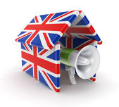 Mega[hone under the roof made on british flags. — Stock Photo