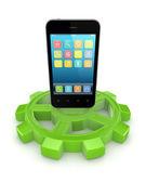 Telefone móvel em uma engrenagem verde. — Foto Stock