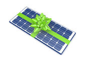 Solar battery decorated with a green ribbon. — Stockfoto