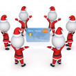 Santas around credit card. — Stock Photo