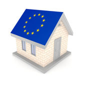 Small house with a flag of EU on a roof. — Stock Photo