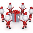 Santas around giftbox. — Stock Photo