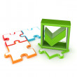 Colorful puzzles and green tick mark. — Stock Photo
