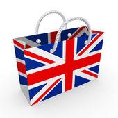 Paket s vlajkou spojeného království. — Stock fotografie