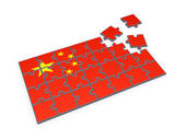 Chinese flag made of puzzles. — Stock Photo