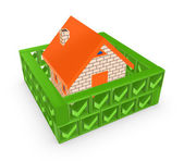 Wall of green tick marks around small house. — Stock Photo