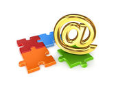 AT symbol and colorful puzzles. — Stock Photo