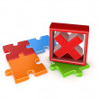 Colorful puzzles and red cross mark. — Stock Photo #26681993