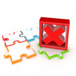 Colorful puzzles and red cross mark. — Stock Photo